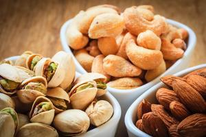 Varieties of Nuts: Cashew, Pistachio, Almond. by Voy