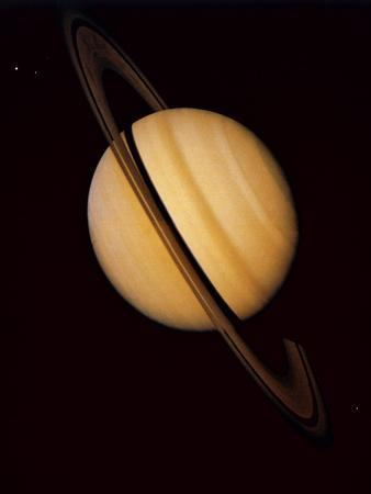 https://imgc.allpostersimages.com/img/posters/voyager-1-image-of-saturn-three-of-its-moons_u-L-PZISOD0.jpg?artPerspective=n
