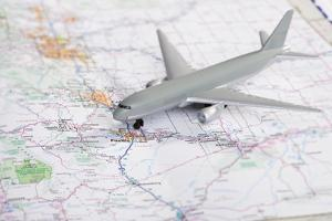 Studio Shot of Toy Airplane on Map by Vstock LLC