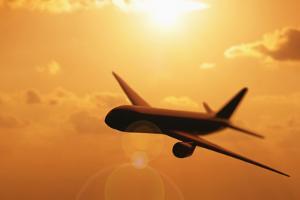Usa, Illinois, Metamora, Silhouette of Airplane at Sunset by Vstock LLC
