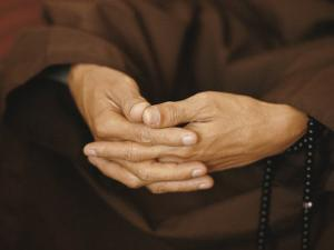 Close View of a Monks Hands Crossed in Prayer by W. E. Garrett