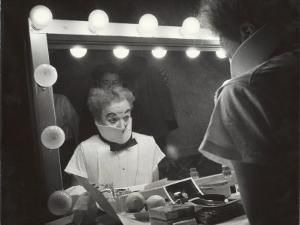 """Actor Charles Chaplin Clowning at Make-Up Mirror During Filming of """"Limelight"""" by W. Eugene Smith"""