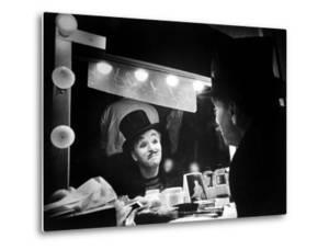 """Actor Charlie Chaplin Looking Putting on Makeup for Role as Animal Trainer in Film """"Limelight"""" by W. Eugene Smith"""