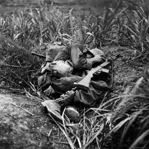 American Infantryman Terry Moore Taking Cover; Japanese Artillery Fire Explodes Nearby During by W. Eugene Smith