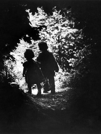 Children of Photographer with Eugene Smith Walking Hand in Hand in Woods Behind His Home