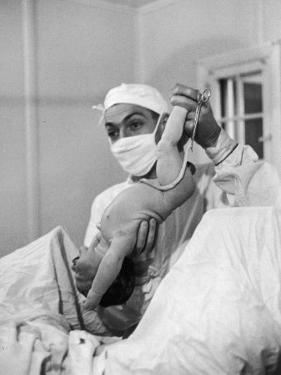 Country Doctor Ernest Ceriani Delivering a Baby by W. Eugene Smith