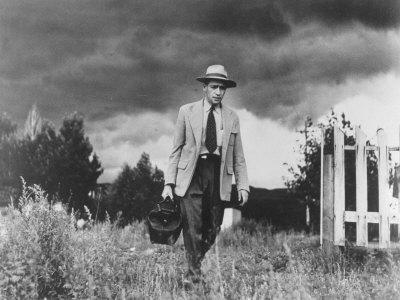 Country Doctor Ernest Ceriani Making House Call on Foot in Small Town