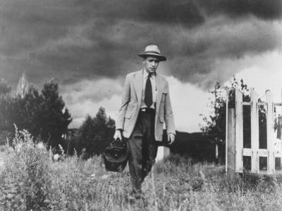 Country Doctor Ernest Ceriani Making House Call on Foot in Small Town by W. Eugene Smith