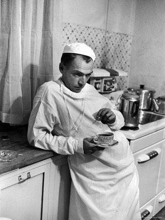 Dr. Ernest Ceriani in a State of Exhaustion, Having a Cup of Coffee in the Hospital Kitchen at 2 AM