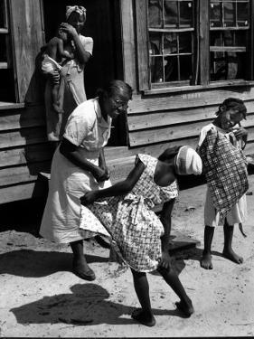 Nurse-Midwife Maude Callen Chatting with 8 and 9 Year Old Sisters Carrie and Mary Jane Covington by W. Eugene Smith