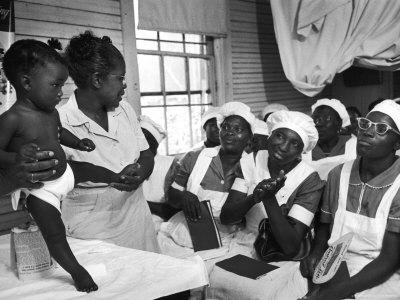 Nurse/Midwife Maude Callen Holds Baby and Teaches Class in Midwifery How to Look for Abnormalities