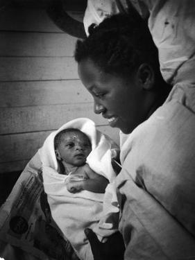 Nurse-Midwife Maude Callen Shows Smiling Alice Her Newborn Son by W. Eugene Smith