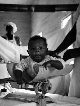 Nurse-Midwife Maude Callen Weighing Baby on Scale by W. Eugene Smith