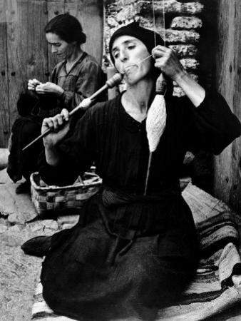Spanish Peasant Using Ancient Methods to Spin Flax Into Thread by W. Eugene Smith