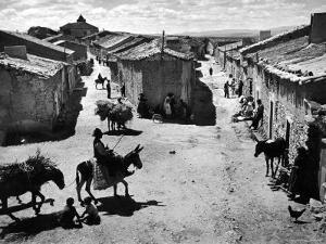 Spanish Village Showing Rows of Crude Stone and Adobe Houses by W. Eugene Smith