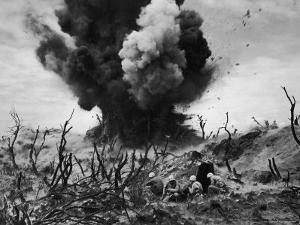 US Marines Crouching Behind Hillside Rock Cover, Blowing Up Cave Connected to Japanese Blockhouse by W. Eugene Smith