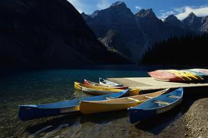 Canoes at Moraine Lake in Banff by W. Perry Conway