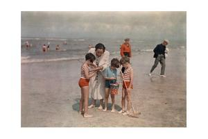 A Lady Examines a Girl's Net While the Other Kids Look at their Own by W. Robert Moore