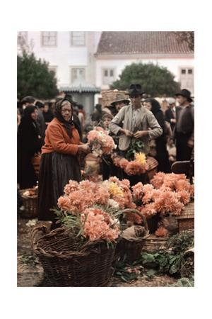 A Man and Woman Sell Flowers at a Market by W. Robert Moore