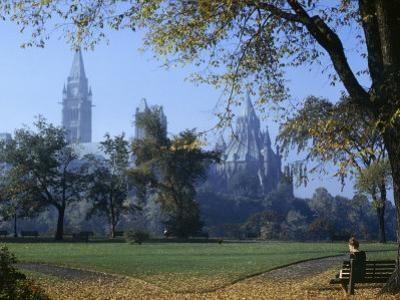 Gothic Parliament Building Towers over an Ottawa Park