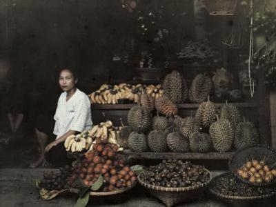 Lady Sits by Her Bangkok Stand of Unique Fruit