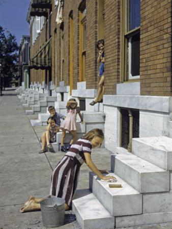 Little Girl Washes Marble Steps of a Row House in Baltimore