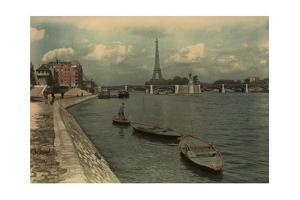 Man Sails on the Seine River Near the Eiffel Tower and Pont Grenelle by W. Robert Moore