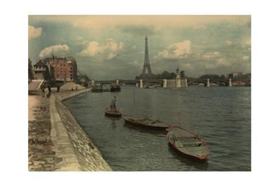 Man Sails on the Seine River Near the Eiffel Tower and Pont Grenelle