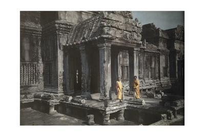 Two Members of the Buddhist Clergy Stand at the Door of Angkor Wat