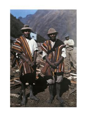 Two Men Pose with their Brilliant Ponchos in the Andean Highlands by W. Robert Moore
