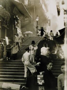 Vendors and Pedestrians Along a Steep Staircase by W. Robert Moore