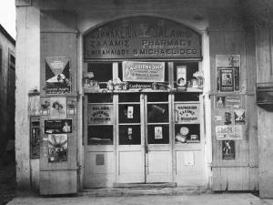 View of the Front of a Neighborhood Drugstore in Cyprus by W. Robert Moore