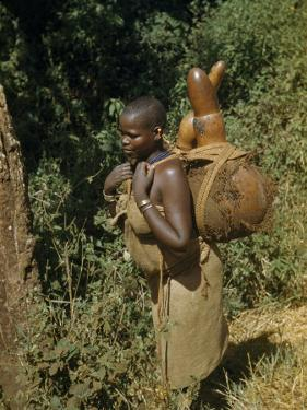 Woman Carries Gourds Filled with Water by W. Robert Moore