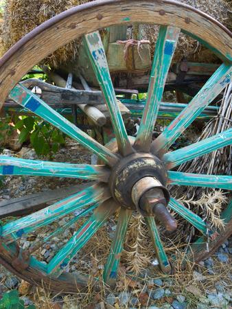 https://imgc.allpostersimages.com/img/posters/wagon-wheels-in-colorful-blues-turkey_u-L-P242AY0.jpg?p=0