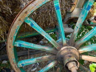 https://imgc.allpostersimages.com/img/posters/wagon-wheels-in-colorful-blues-turkey_u-L-P242C10.jpg?p=0