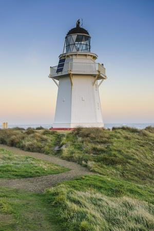 https://imgc.allpostersimages.com/img/posters/waipapa-point-lighthouse-at-sunset-the-catlins-south-island-new-zealand-pacific_u-L-PQ8QPN0.jpg?p=0