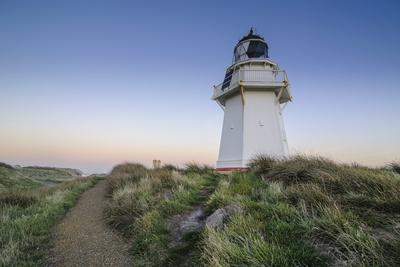 https://imgc.allpostersimages.com/img/posters/waipapa-point-lighthouse-at-sunset-the-catlins-south-island-new-zealand_u-L-PQ8MVZ0.jpg?p=0