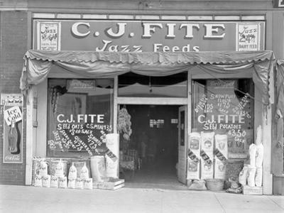 Feed store front, Alabama, 1936 by Walker Evans