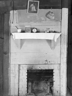 Fireplace in the bedroom of Floyd Burroughs' cabin in Hale County, Alabama, c.1936 by Walker Evans
