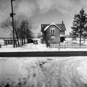 House in the Country, as Seen from Train Window by Walker Evans