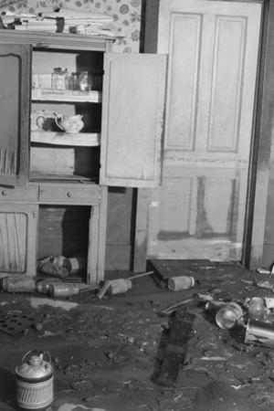 Interior of a farmhouse near Ridgeley, Tennessee, after the flood waters had subsided, 1937 by Walker Evans