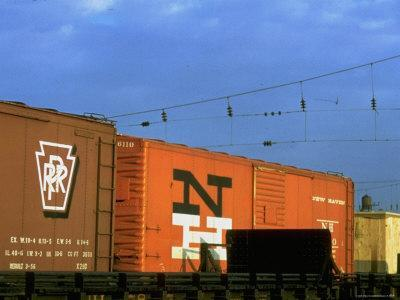 Line of Box Cars Dramatically Lit by Late Day Sunlight