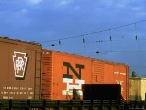 Line of Box Cars Dramatically Lit by Late Day Sunlight by Walker Evans