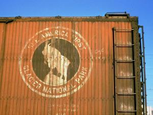 Old Weathered Box Car Showing Design Promoting Travel to Glacier National Park by Walker Evans