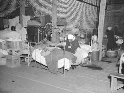 Patient in a Red Cross temporary infirmary for flood refugees at Forrest City, Arkansas, 1937 by Walker Evans