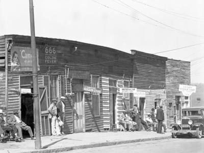 person shop fronts in Vicksburg, Mississippi, 1936 by Walker Evans