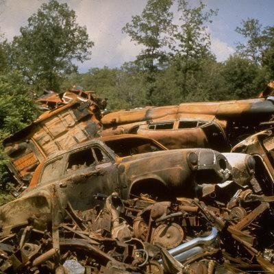 Pile of Rusted Car Shells in an Automobile Junkyard