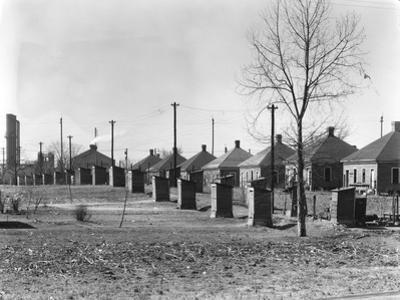 Republic Steel Company workers' houses and outhouses in Birmingham, Alabama, 1936 by Walker Evans
