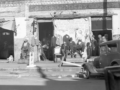 Sidewalk scene in Selma, Alabama, 1935 by Walker Evans