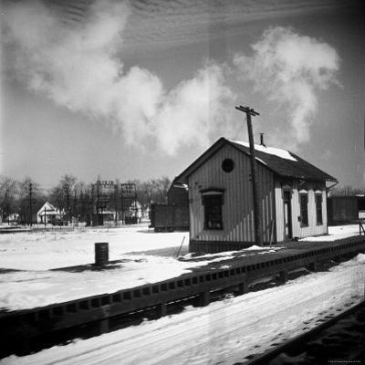 Small Railroad Station in Unidentified American Town, as Seen from Train Window by Walker Evans